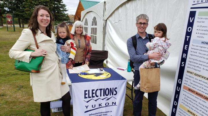 Family at Elections Yukon Booth